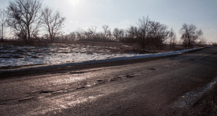 potholes forming asphalt pavement